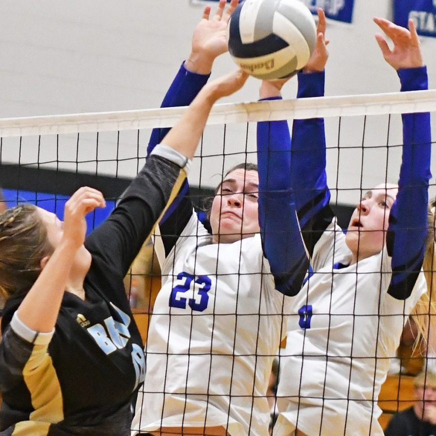 Jozy Piper (left) and Kennedy Warneke combine for a block against BRLD in the Lady Jays' three-set win Monday evening in sub-district action.